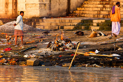 Thumbnail image of Cremation pyre along the Ganges riverbank.
