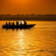 Boats at sunrise, on the River Ganges.