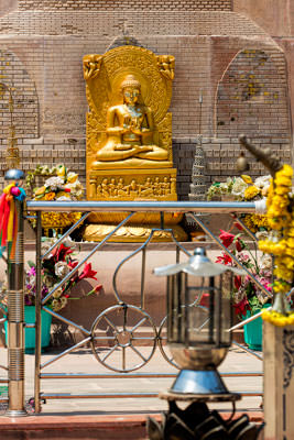 Thumbnail image ofSmall Buddha image at the base of the standing...