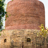 Large and very old Dhamek stupa at Sarnath where the first sermon by Gautama Buddha was delivered.