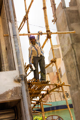 Thumbnail image ofWorker on bamboo scaffolding.