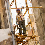 Worker on bamboo scaffolding.
