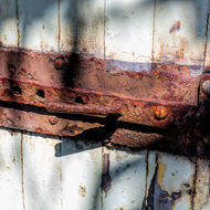 Rusty door hardware on old house.