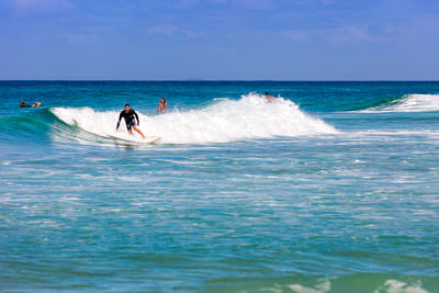 Thumbnail image of Surfing at the northern end of Teewah Beach.