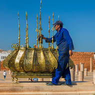 Polishing the ceremonial lantern at the Mausoleum of King Mohammed V.