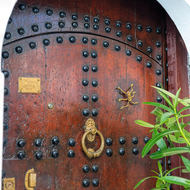 Decorated and well maintained door.
