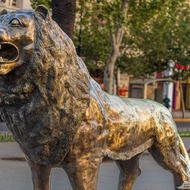 Lion statue in the center of Hassan II avenue.