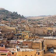 Panorama of old Fes and the dry hills beyond, piazza center field.
