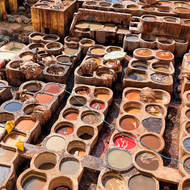 Vats of colored dyes for leather.