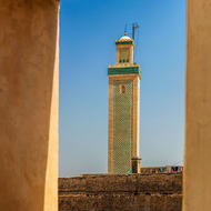 Minaret through a caravanserai turret.