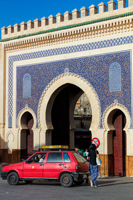 Thumbnail image ofGateway into old Fes with little red taxi doing...