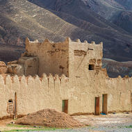 Kasbah in the mountains with some sign of habitation.