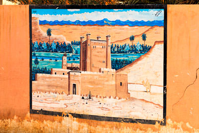 Thumbnail image ofStreet art depicts a kasbah and date palms