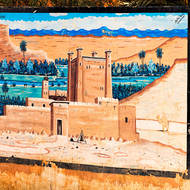Street art depicts a kasbah and date palms