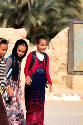 Thumbnail image ofThree girls on their way to school.