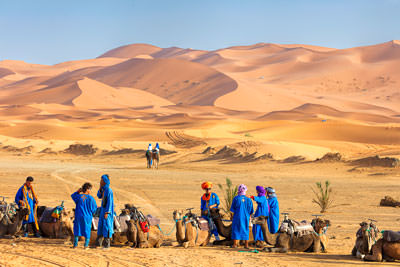 Thumbnail image ofReadying for a dune trip, Tuareg camel handlers.