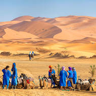 Readying for a dune trip, Tuareg camel handlers.