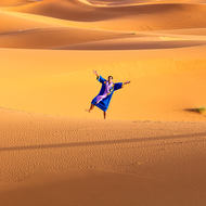 Tuareg man barefoot in the sand.