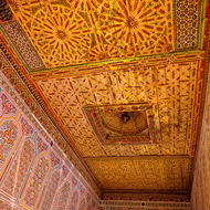 Ornately decorated ceiling in a kasbah room.