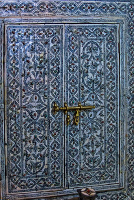 Thumbnail image ofDecorated door with brass fittings.