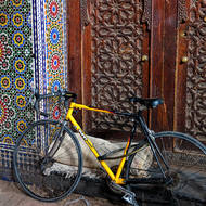 Locked bicycle in a doorway.