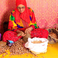 Cracking argan nuts with rocks.