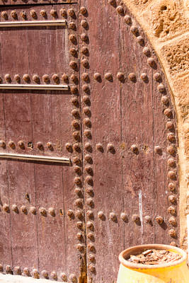 Thumbnail image ofRiveted door in the city rampart.