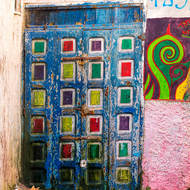 Colorful door, street art and alley cat.