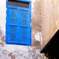 Blue shuttered window over star of Morocco.