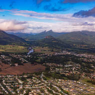 Looking west over the town of Murwillumbah, the Tweed River and Mt Warning in the clouds.