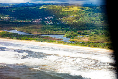 Thumbnail image ofSurf rolls on to Tallow beach, Tallow Creek back...