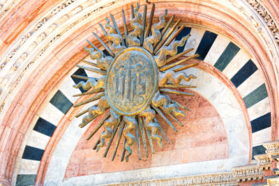 Thumbnail image ofIHS monogram on the front of the Duomo.