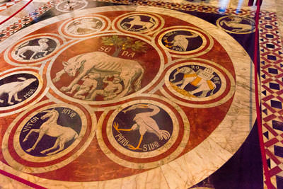 Thumbnail image of Marble mosaic inside the Duomo places Siena at...