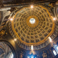 Looking up into the 12-sided dome of the Duomo.