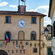 Clock and plaques on Piazza Francesco Ferrucci.