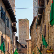 Streets of San Gimignano and, center, Torre Pettini.