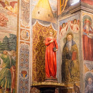 Frescoes and statue inside the Duomo of San Gimignano, Basilica Collegiata di Santa Maria Assunta.