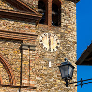 Clock and bell tower of Santa Maria Assunta church in Panzano.