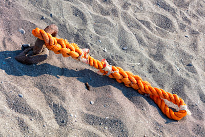 Thumbnail image ofTie rope, pinned into the sand.