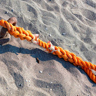 Tie rope, pinned into the sand.