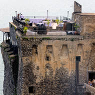 Restaurant tops fortification tower, staff readies for supper service.