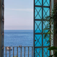 Positano harbor through Santa Maria Assunta in Positano church window.