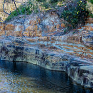 Banded sandstone overlying basalt at Angourie Blue Pool.