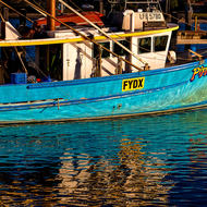 Fishing boat in harbour.