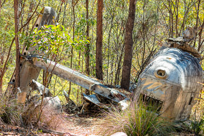Thumbnail image of Upturned tail section from crashed B24 Liberator...