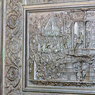 Death by inverted hanging, panel in a door of St. Peter's Basilica.