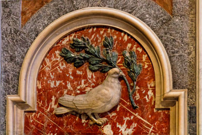 Thumbnail image of Dove carrying an olive branch.