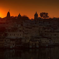 Sun rises over buildings around Lake Pichola.
