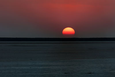 Thumbnail image of Sun starts to disappear into the haze on the horizon.
