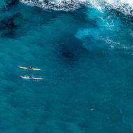 Kayakers just beyond dangerous waters.